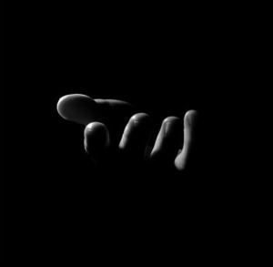 Hand in darkness